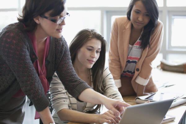 College teacher helping female students